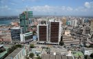 A general picture shows the skyline of Tanzania's port city of Dar es Salaam, July 12, 2013. Tanzania's commercial capital looks like a boom town even before cash rolls in from gas discoveries that in the next few years could make the east African nation a major energy exporter. Glass-clad tower blocks pierce Dar es Salaam's sky-line and more are emerging from noisy building sites. Billboards advertise high-definition televisions and other electronics to a new middle class, who crowd brand new shopping malls. REUTERS/Andrew Emmanuel (TANZANIA - Tags: SOCIETY BUSINESS ENERGY) - GM1E97C1S1L01